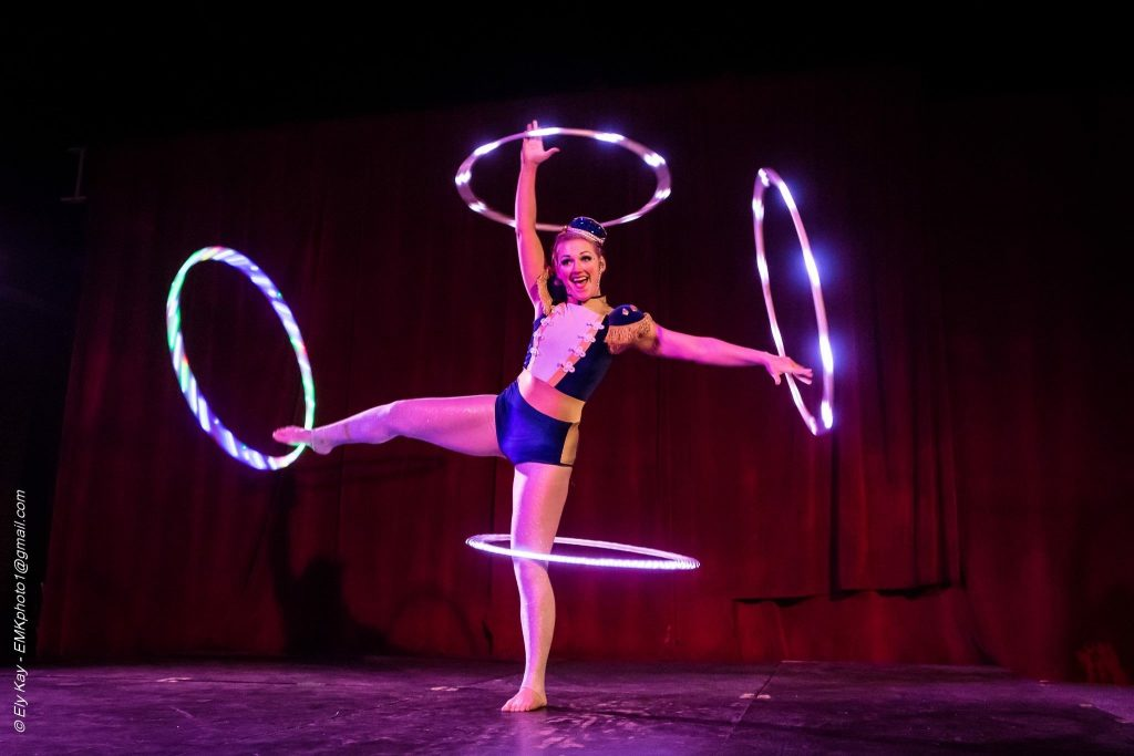 Natalie McFancy spins a hoop on every limb!